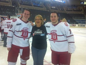 Jan Sweeney celebrates with Seamus Malone and Keegan Ford after they helped the Fighting Saints win the Clark Cup last May