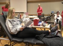 Loras student giving blood