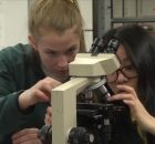 High School Students with microscope