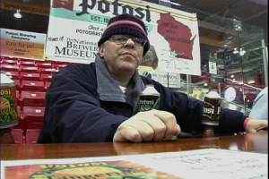 Beer Historian Lance Rice serving Potosi beer to the attendees at Dubuque on Ice Brewfest