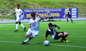 Senior forward Dillon Olson dribbles past a defender during the Duhawks' 2-2 tie Sunday with UW-Oshkosh in the Rock Bowl.